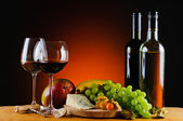 Cheese, wine and fruits — Stock Photo