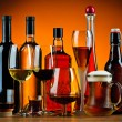 Stock Photo: Bottles and glasses of alcohol drinks