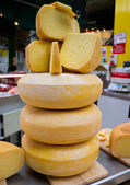 Pile of traditional cheese at market — Stock Photo
