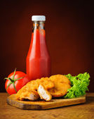 Chicken nuggets and tomato ketchup — Stock Photo