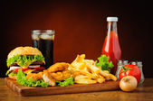 Fast food menu with hamburger, chicken nuggets and french fries — Stock Photo