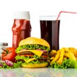 Cheeseburger, french fries, drink and ketchup — Stock Photo