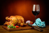 Roasted chicken and red wine — Stock Photo