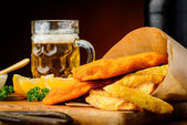 Fish and chips meal and beer — Stock Photo