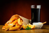 Fish, chips and cola drink — Stock Photo