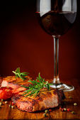 Grilled meat and red wine — Stock Photo