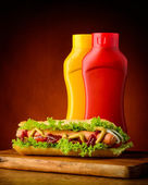 Hotdog with ketchup and mustard — Stock Photo