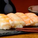 Nigiri sushi with prawns and soy sauce — Stock Photo #41351027