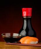 Salmon nigiri sushi with soy sauce — Stock Photo