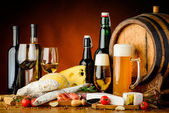 Wine, beer and food — Stock Photo