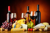 Cheese, wine and grapes — Stock Photo
