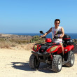 Stock Photo: Young tourist in ATV