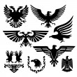 Stock Vector: Silhouette eagle emblem government heritage