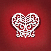 The heart of the white paper on red background — Stock Photo