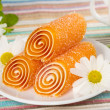 Stock Photo: Orange colorful candies jelly with flower, background