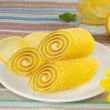 Yellow candy fruit on a plate with lemon and flower — Stock Photo #17698841