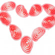 Candy fruit coated candy hearts arranged in the shape of a heart, Isolated — Stock Photo
