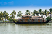Beautiful landscape with reflection houseboat in kerala backwaters, India — Stock Photo
