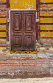 The old door without steps and handle is located high above the ground — Stock Photo