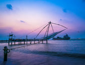 Kochi chinese fishnets and vessel on sunset in Kerala. Fort Koc — Stock Photo