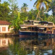 Reflection houseboat and house in kerala backwaters, India — Stock Photo