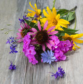 Bouquet of flowers on a wooden background — Stock Photo