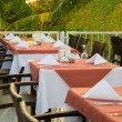 Tables at the restaurant, served for a supper on an open terrace — Stock Photo #30970323