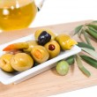 Постер, плакат: Stuffed olives with olive oil and branch of an olive tree on a