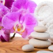 Spa still life with stone, lilac orchid and towel — Stock Photo