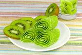Candy fruit with slices kiwi on a plate — Stock Photo