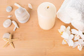 Spa still life with orchid, stones, candle burning and towel on — Stock Photo