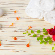 Spstill life with stone, flowers  and white towel on wood back — Stock Photo #41913307