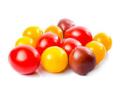 Fresh ripe red, yellow and black cherry tomatoes is isolated on — Stok fotoğraf