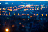 City lights in the evening with blurring background — Stock Photo