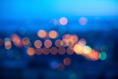 Blurring big abstract circular lights bokeh on blue background — Stock Photo