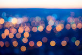 City lights big abstract circular bokeh on blue background with  — Stock Photo