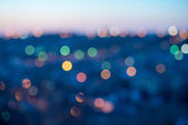 City lights abstract circular bokeh on blue background — Stock Photo