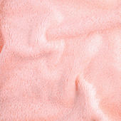 Pink texture of bath towel folded as a background — Stock Photo