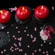 Spa concept of red candles on zen stones with drops, orchid camb — Stock Photo #50008449