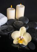 Beautiful spa set of yellow orchid (phalaenopsis), zen stones wi — Stock Photo