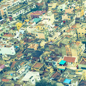 retro style  image of colorful homes in crowded Indian city Tri — Stock Photo