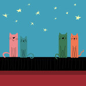Colored cats sitting on the roof — Stock Vector