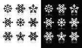Schneeflocken-icons mit schatten auf schwarzen und weißen hintergrund — Stockvektor