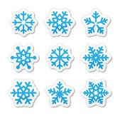 Conjunto de iconos de los copos de nieve de navidad — Vector de stock