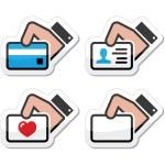 ręka trzyma karty kredytowej, wizytówki, identyfikator Ikony Ustaw jako etykiety — Wektor stockowy