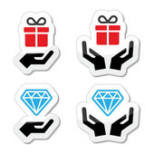 Hands with present and diamond icons set — Stock Vector