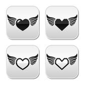 Heart with wings buttons set — Stock Vector