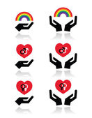 Rainbow, gay and lesbian symbols in heart with hands — Stock Vector