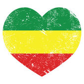 Rasta, Rastafarian retro heart shaped flag — Stock Vector