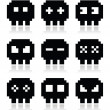 Pixelated 8bit skull vector icons set — Stock Vector
